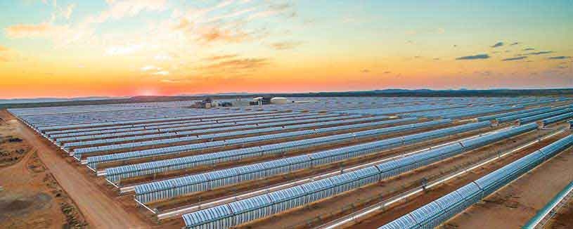 acwapower-bokpoort-birds-eye-sunset-behind-solar-plant